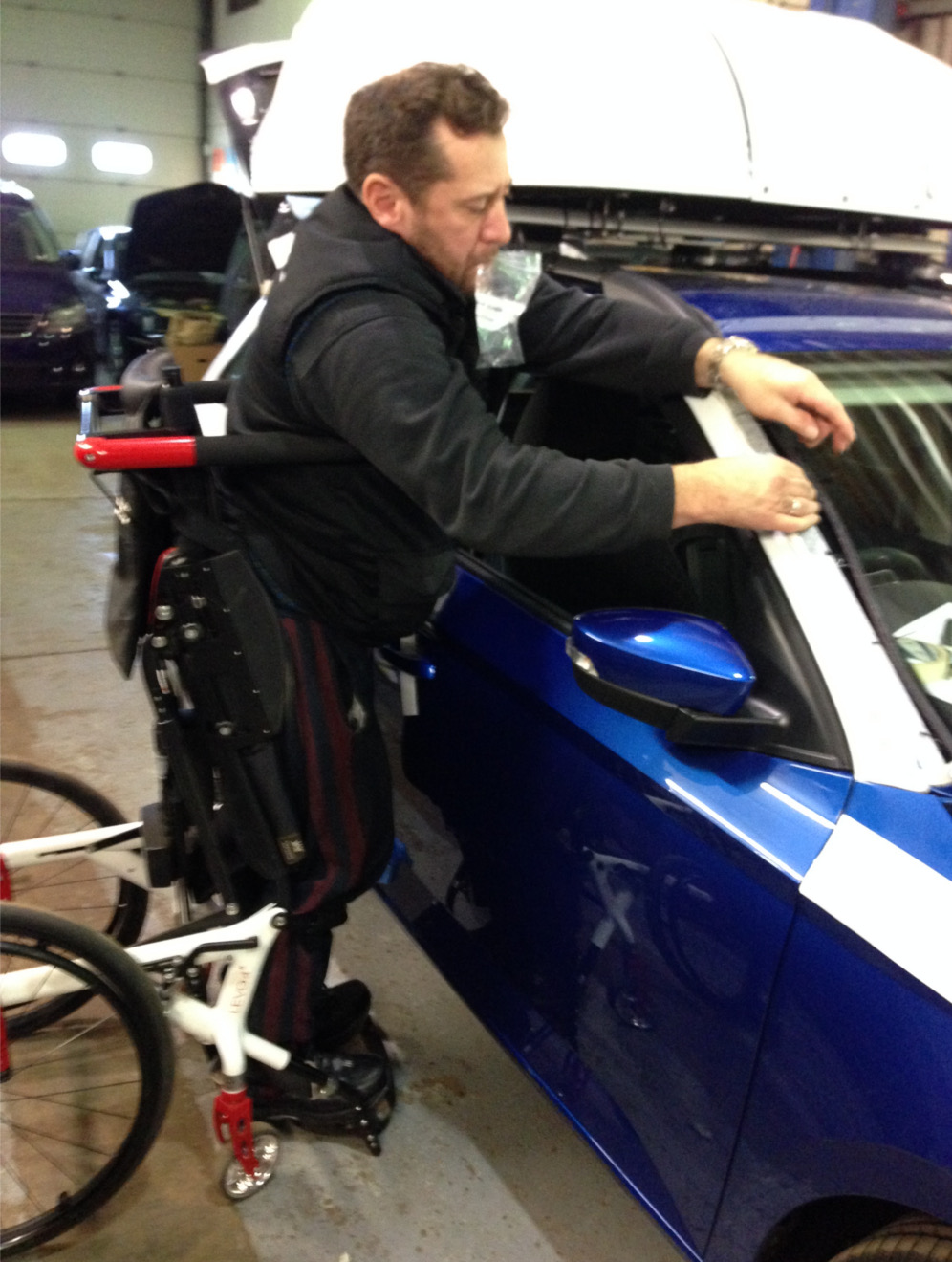 Andy working on a disabled car adaptation