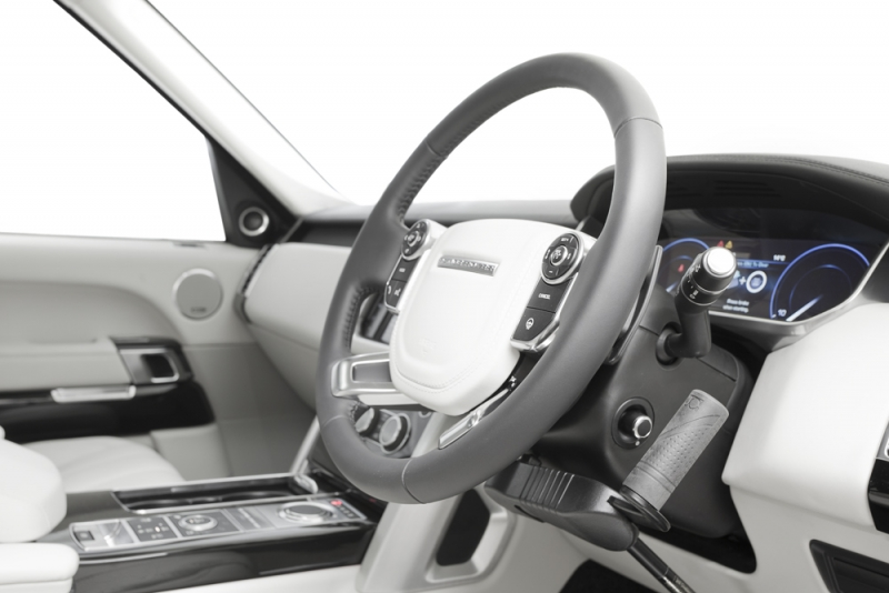 Jeff Gosling hand controls for disabled drivers, showing integrated leg impact system